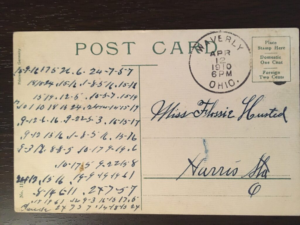 No stamp (missing). Postmark Waverly Ohio, 6pm 12 April 1910. Addressed to Miss Flossie Husted Harris Sta. O. Message is in a code taking the form of long strings of numbers.