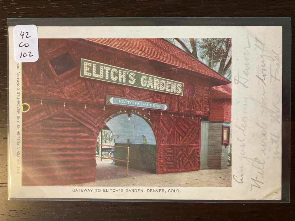 Large wooden entrance to Elitch's Gardens with two signs over an archway.