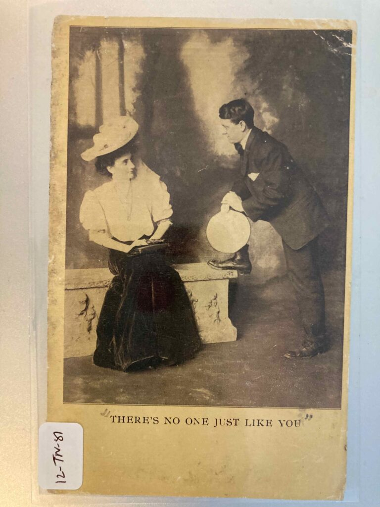 """Woman sitting on a bench reading a book. A man standing with one foot on the bench. Caption: """"There's no one just like you."""""""