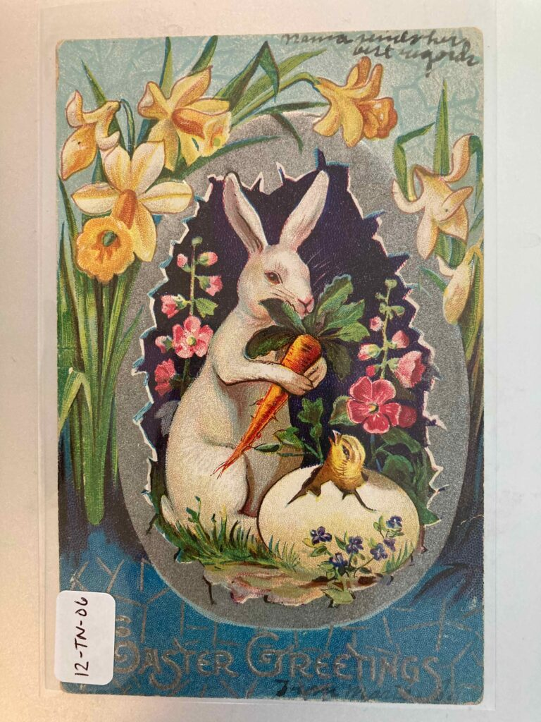 """A rabbit, carrot, flowers, and a hatching chicken within a larger eggshell. Printed message """"Easter Greetings"""" plus handwritten note at the top """"Mama sends her best regards"""""""