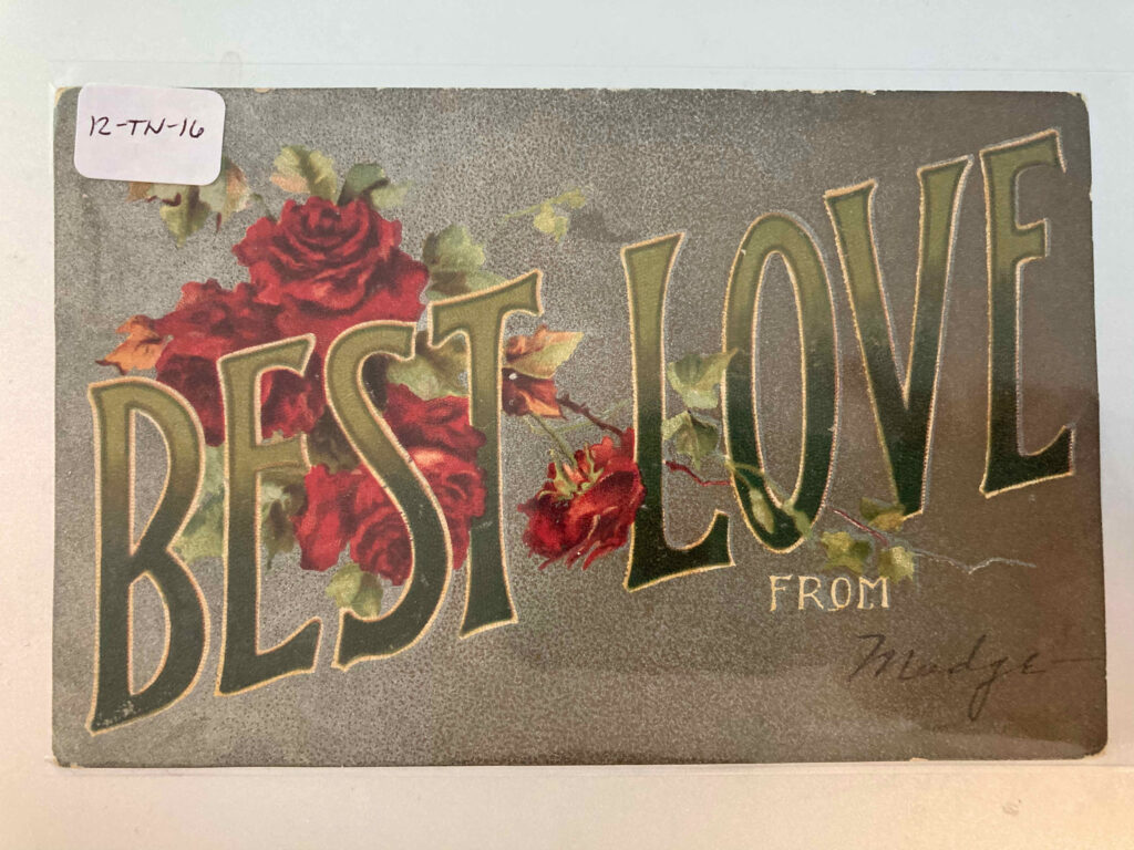 """Roses and the caption """"Best Love from"""" with """"Madge"""" added in handwriting"""